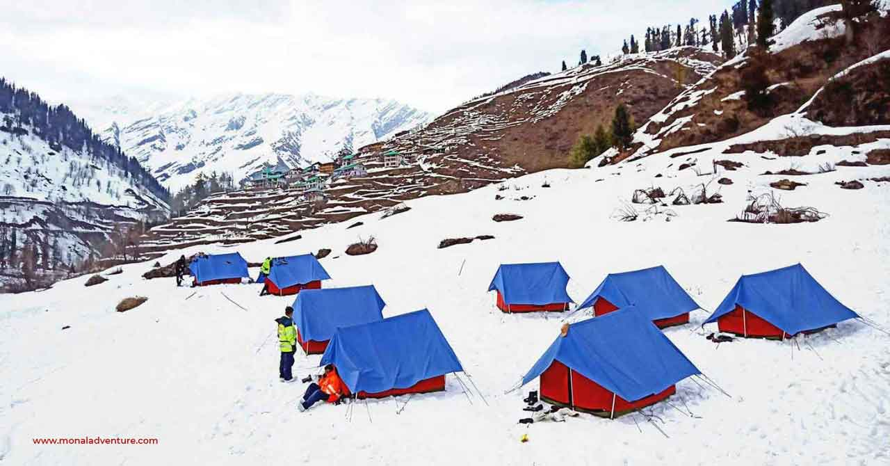 The photo shows a snowfield with some swiss tents pitched in. The photo is regarding chopta camps in winters.
